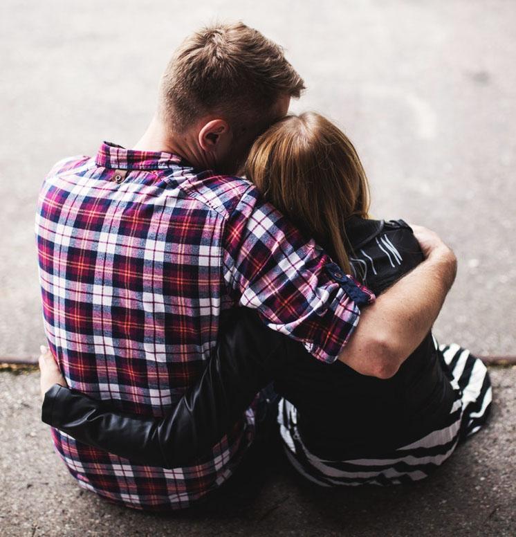friends hugging sitting together.jpg
