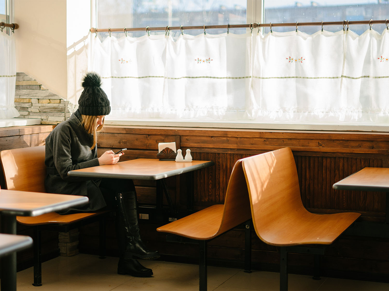 solo lonely woman in coffee shop.jpg