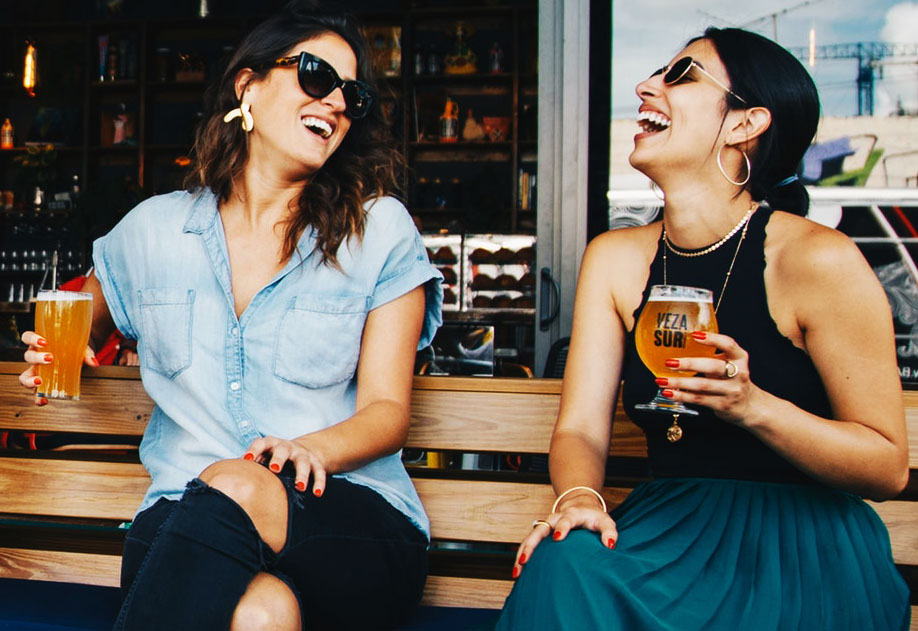 two girls laughing happy hour.jpg