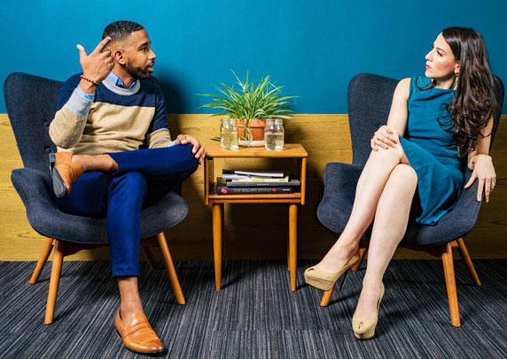 two people displaying workplace body language.jpg