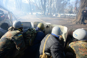 Barricade_line_separating_interior_troops_and_protesters_seen_as_the_conflict_develops._Clashes_in_Kyiv_Ukraine._Events_of_February_18_2014-300x200.jpg