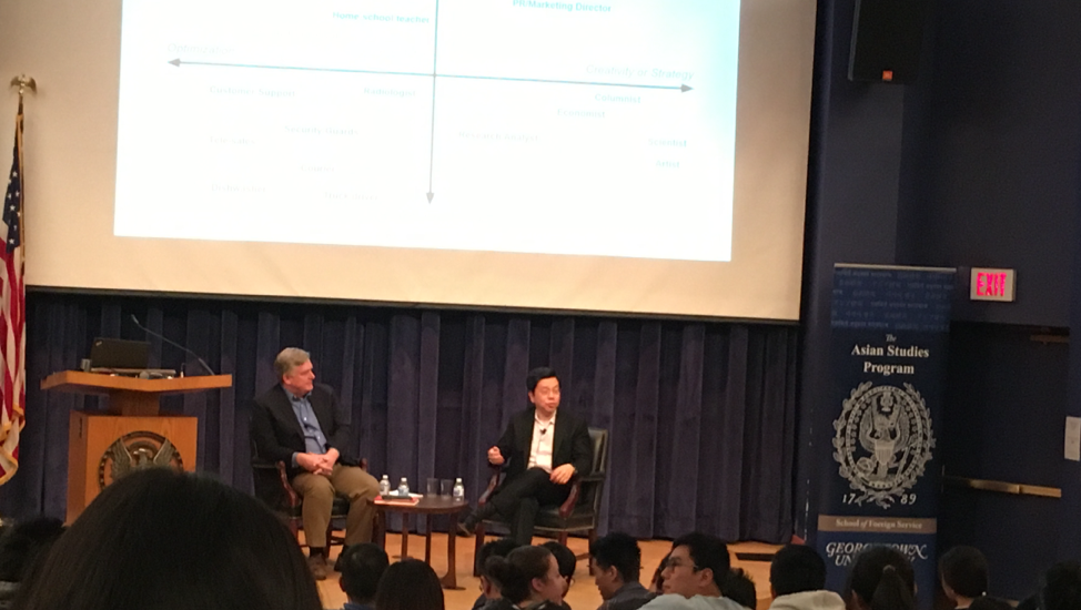 Dennis Wilder (left) and Dr. Kai-Fu Lee (right) speaking at the event on November 17