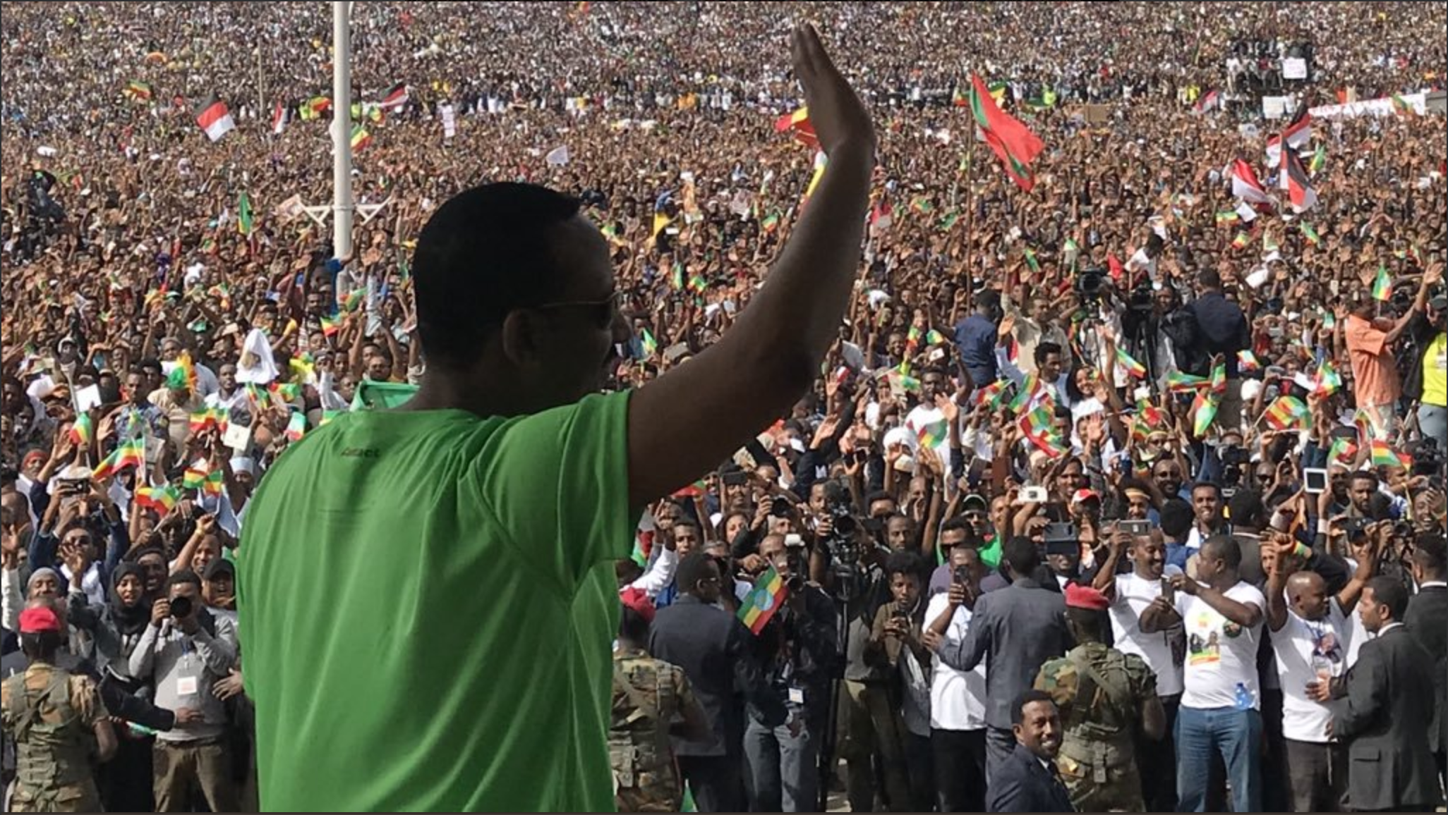 Abiy Ahmed, Prime Minister of Ethiopia, waves at a rally.