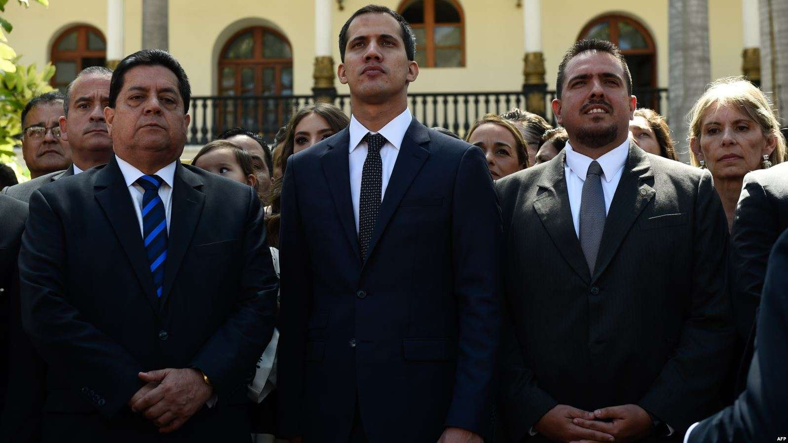 President of Venezuela's National Assembly and self-declared interim president of Venezuela, Juan Guaidó, stands in the center with members of the Assembly after their inauguration ceremony on January 5 in Caracas. (Wikimedia Commons)