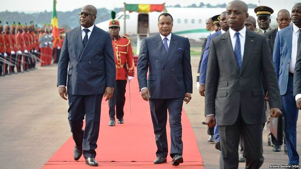 President Tshisekedi of the D.R.C. walks with other regional leaders at the Brazzaville airport. ( Wikimedia Commons)