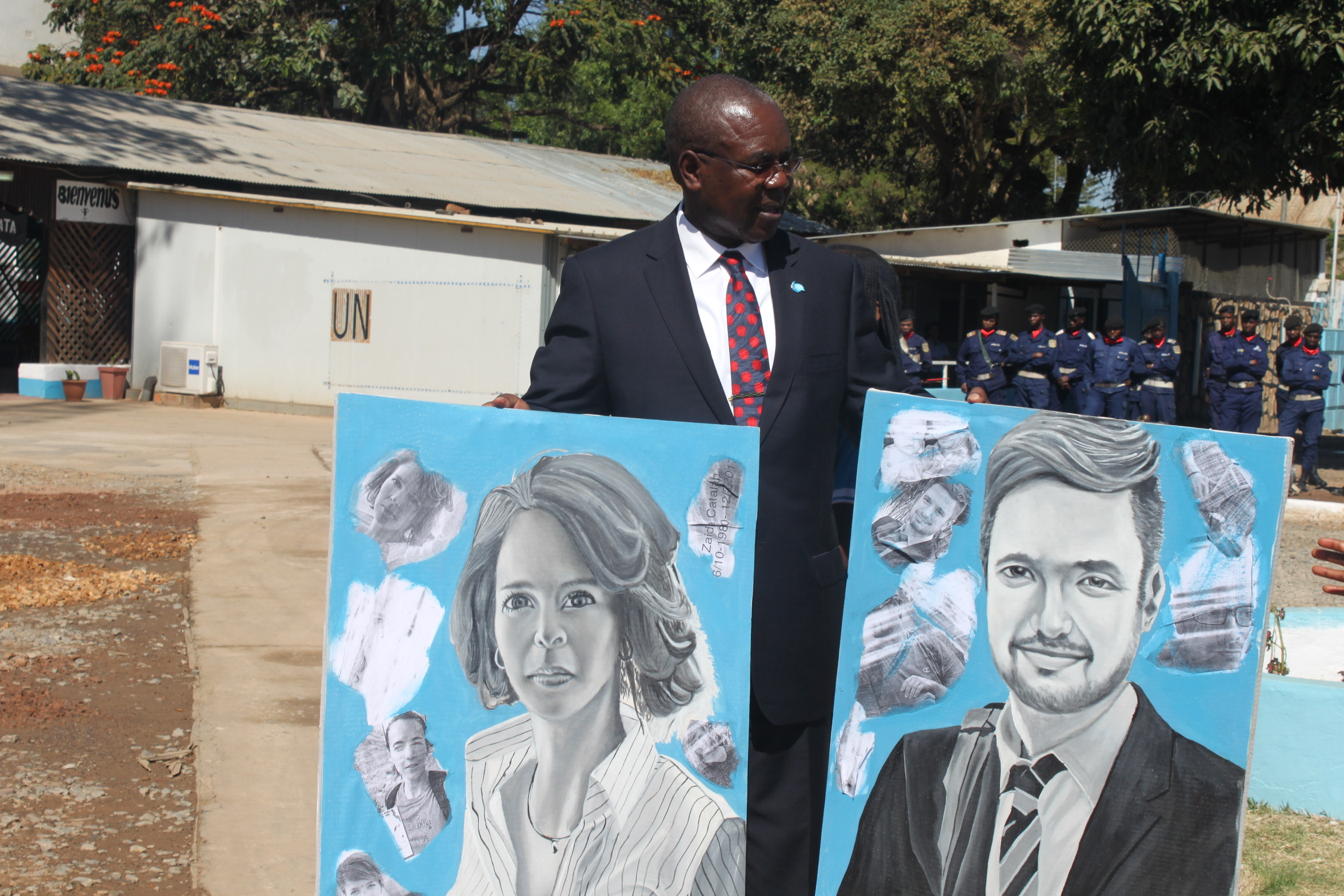 The Chief of MONUSCO Office, Josiah Obat, displays portraits of two murdered UN experts, Zaida Catalan and Michael Sharp. ( Flickr )