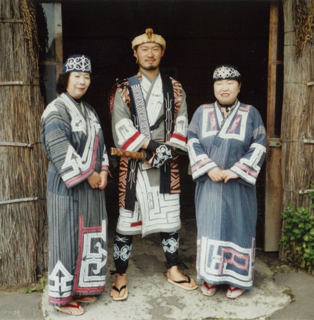 Ainu people pose in traditional clothing at the Ainu Museum in Hokkaido, Japan. (Wikimedia Commons)