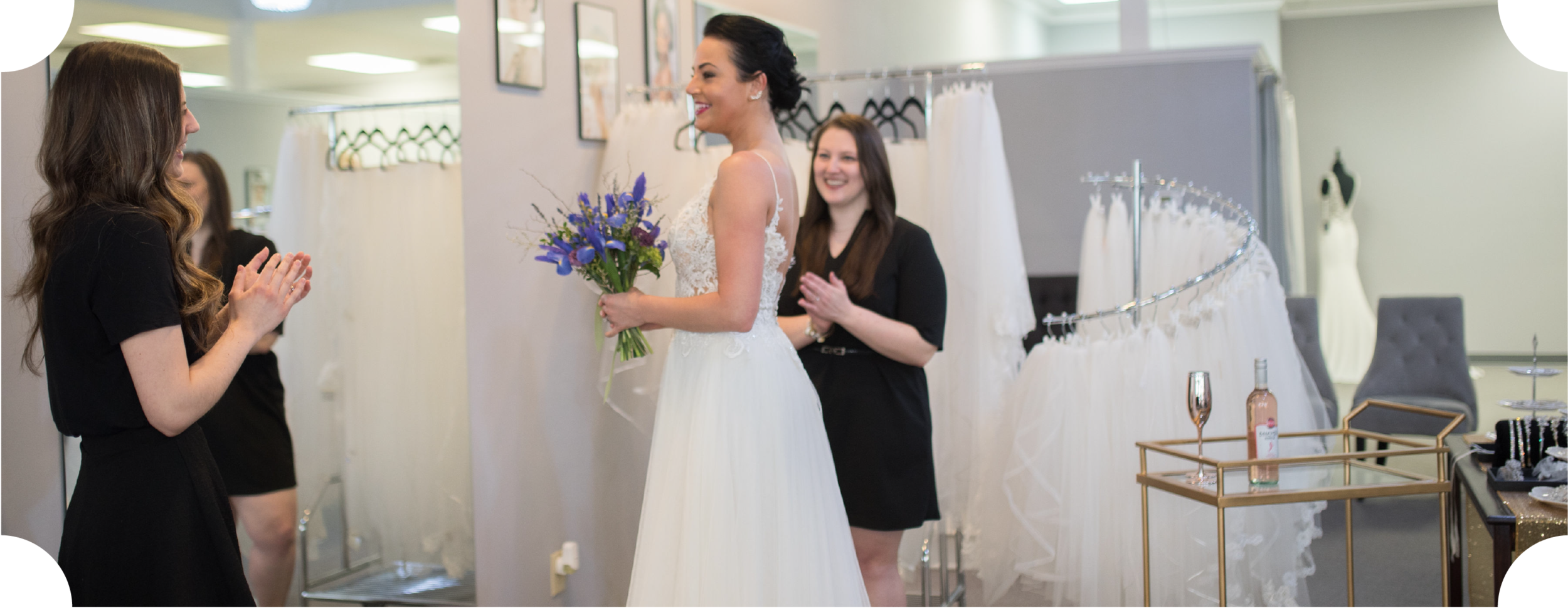 stylists congratulating a bride on finding her perfect dress