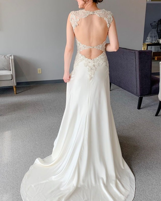 The back of this gown! This silky satin gown has the most gorgeous beaded bodice with a double keyhole back, don't you agree?!   #weddings #love #bridalgowns #bridaldress #gowns #bridalshop #weddinggowns #engaged #weddingdress #weddingday #dresses