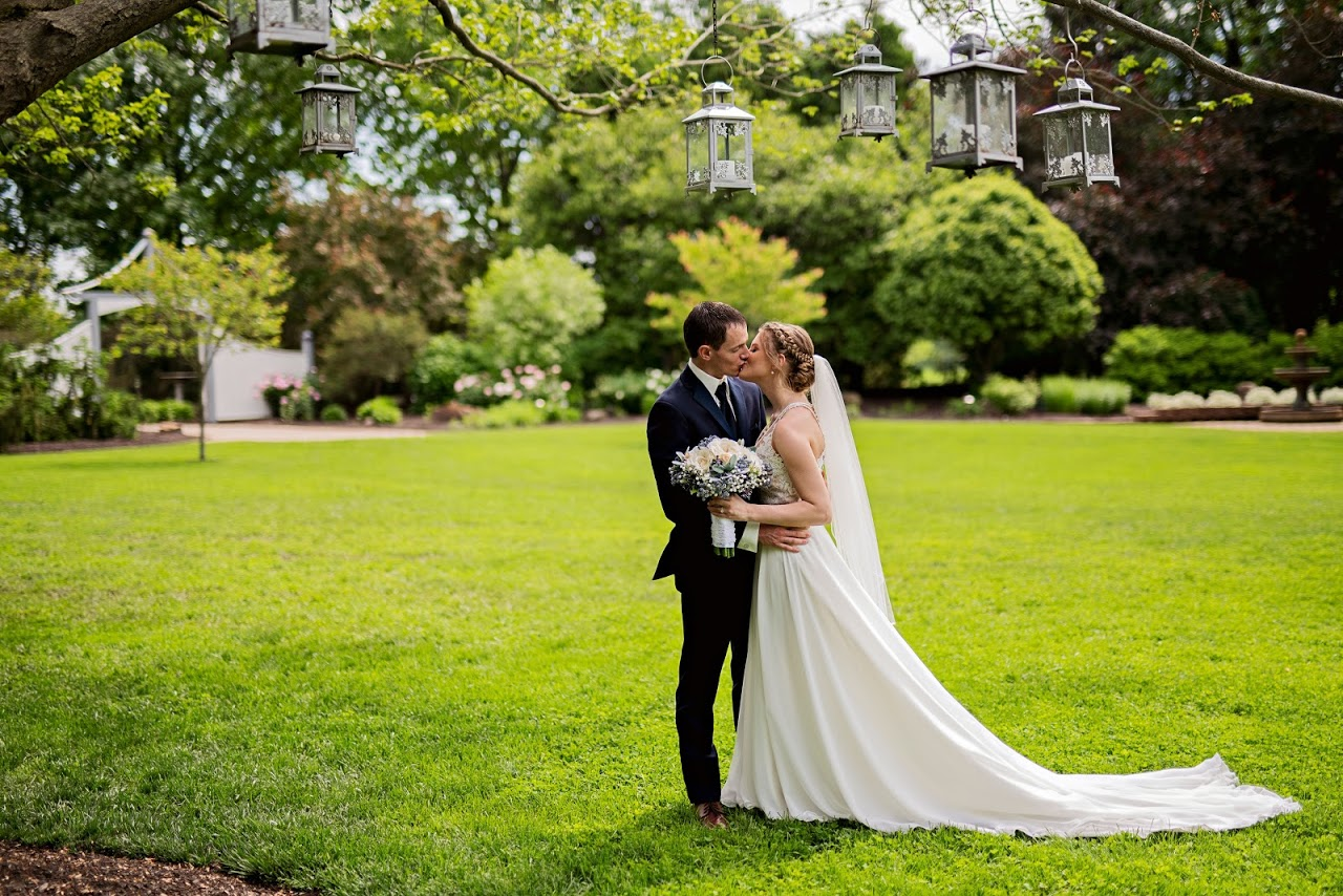 bride and groom kiss in the garden
