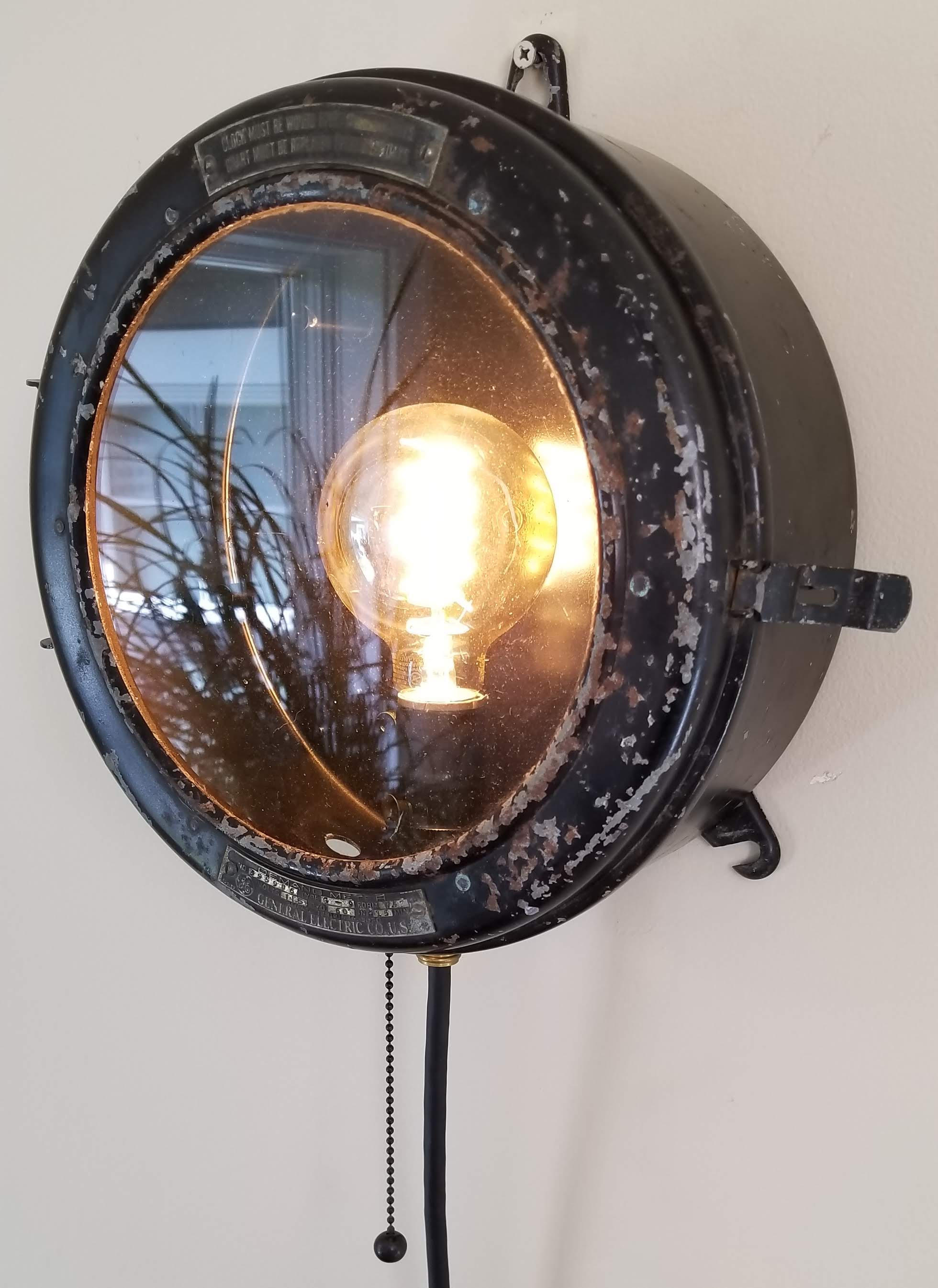 "SOLD.  This old BCM meter from the 1940's has been gutted and refitted to function as a wall fixture with a great industrial feel.  Diameter: 10"" Depth: 5"""