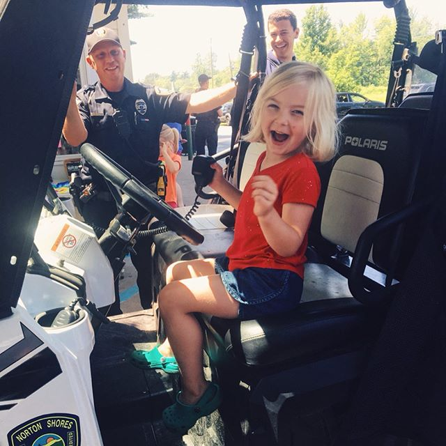 "Bumped into some officers from the Norton Shores Police Dept while we were in MI. Cops n' Cones day at the Whippi-Dip. The kids were very excited about sitting in the police vehicles and talking through the loudspeaker, ""free ice cream!"" 😆❤️"