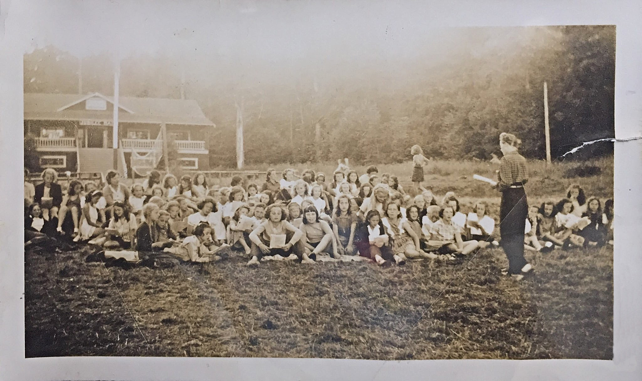 Pictured: Girls assembled on the main field at Camp Fircom in the late 1940s. Courtesy of Lorraine Elliott.