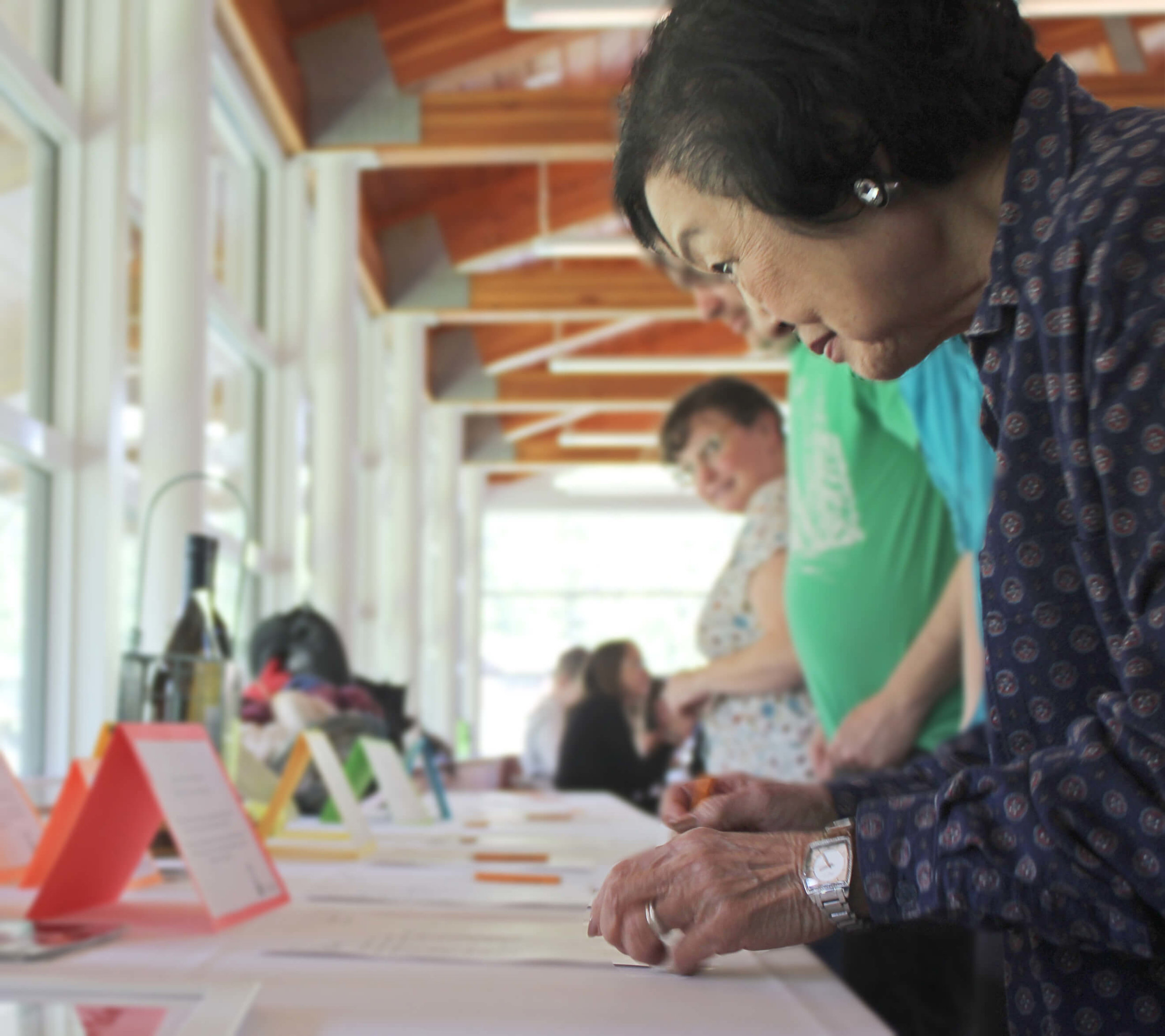 Pictured: Lorraine bidding at the Camp Fancy 2019 silent auction.