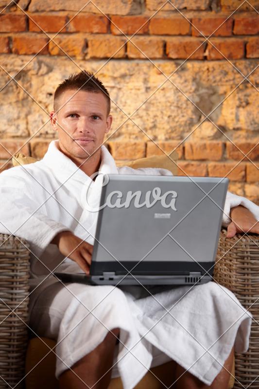 canva-handsome-man-in-bathrobe-with-computer-MABkbpQy1rU.jpg