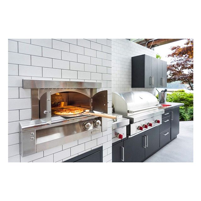 Brrrr 🥶 it's that time of year to get cozy round a fire and eat pizza. Throwback to our Indian Arm project a couple years ago. #outdoorkitchen #kitchendesign #design . . . . #landscape #landscapedesign #vancouver #northvancouver #interiordesign #architecture #view #penthouse #realestate #outdoorliving #vancouverrealestate #bachelorpad #luxury #luxuryrealestate #architecture #architectureporn  #modern #bbq #grill