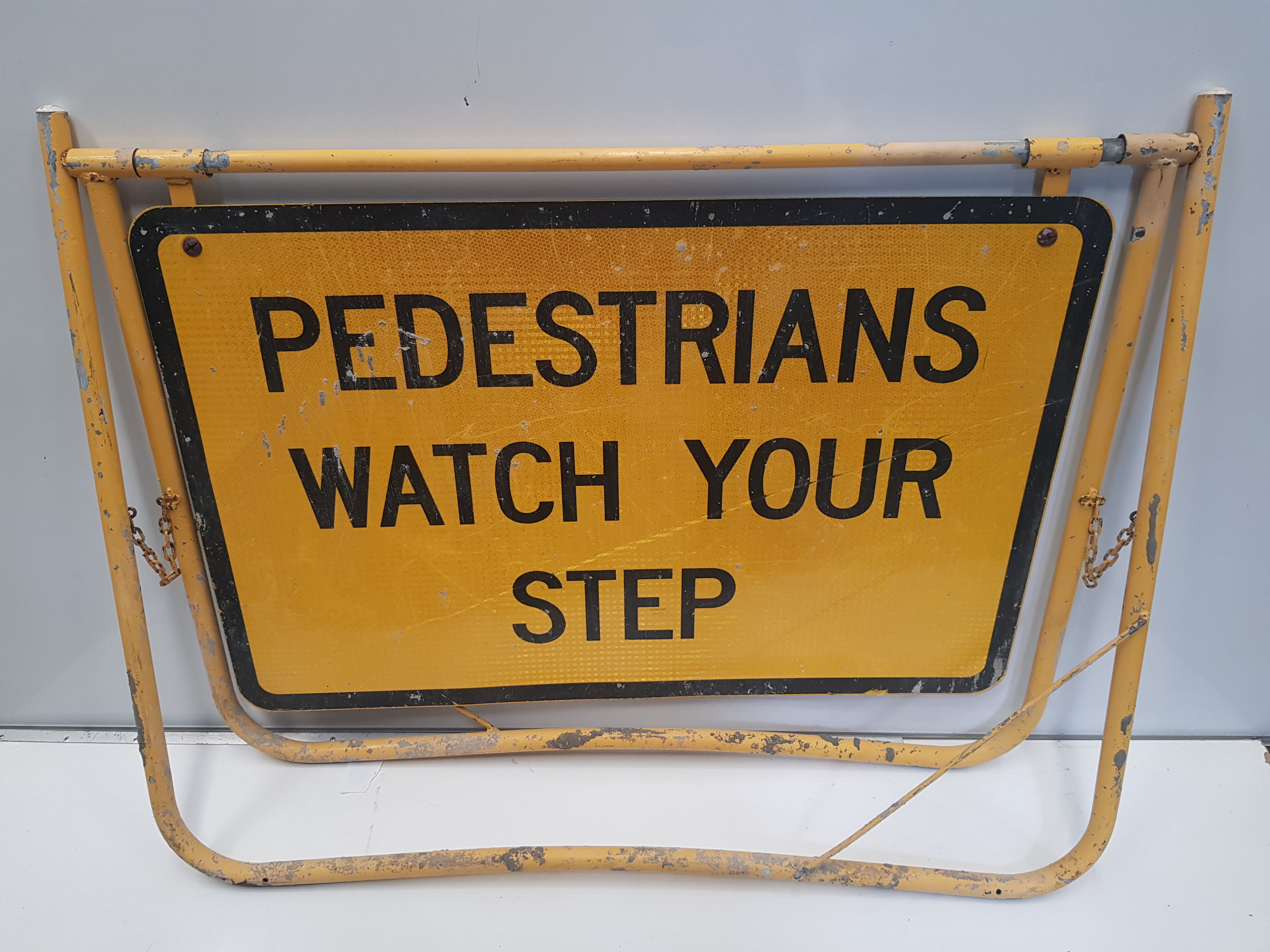 Pedestrians Watch Your Step Swing Stand Sign.jpg