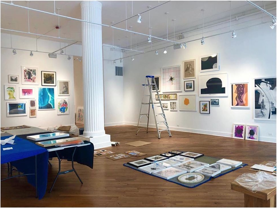 "Installation shot of the SALON show at David Klein Gallery. Image from David Klein Gallery. You can see ""Being a Woman"" in the upper left corner."