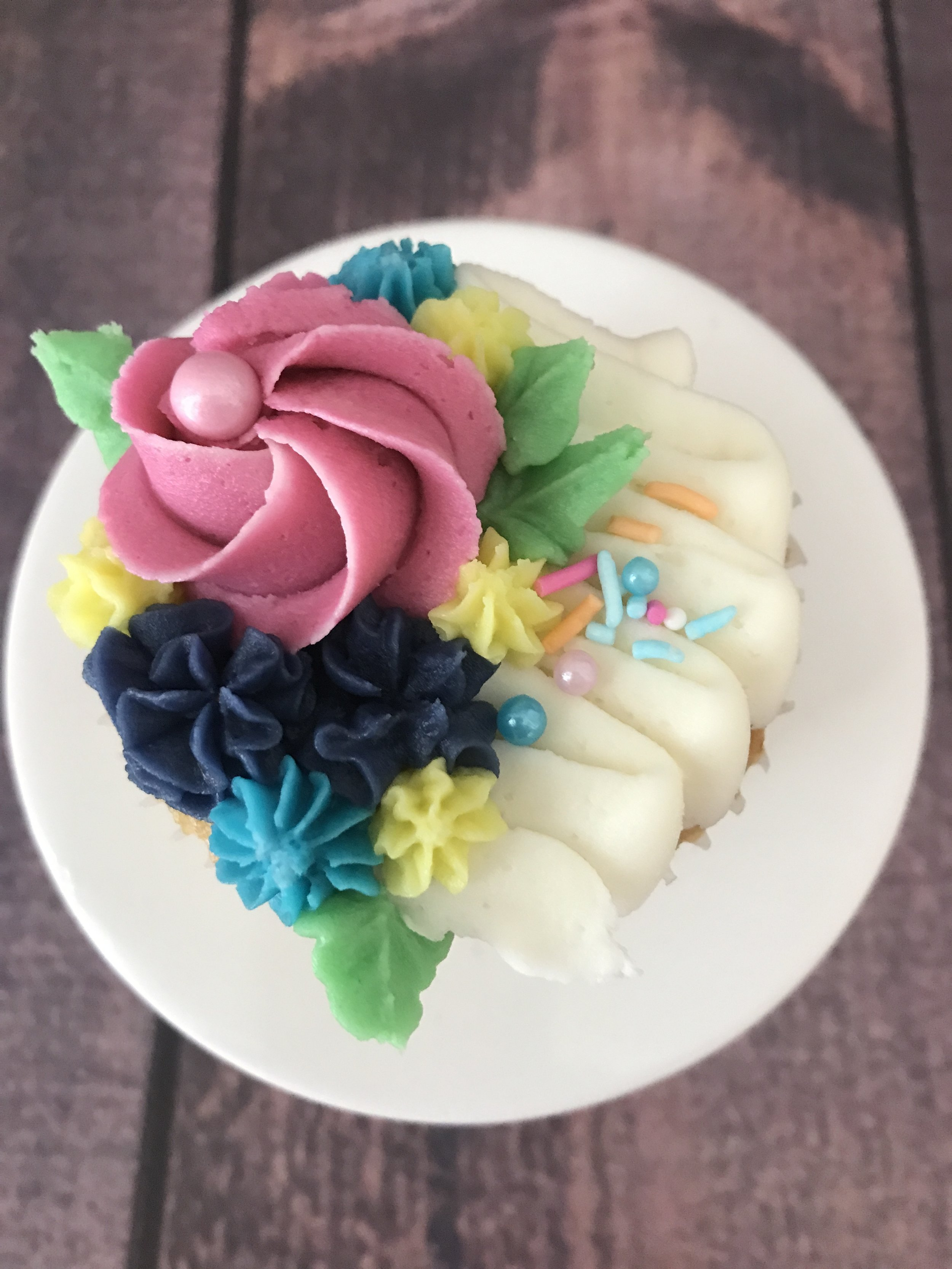 Flowers…ON a cupcake.  That's like two gifts in one!  ($39/dozen)