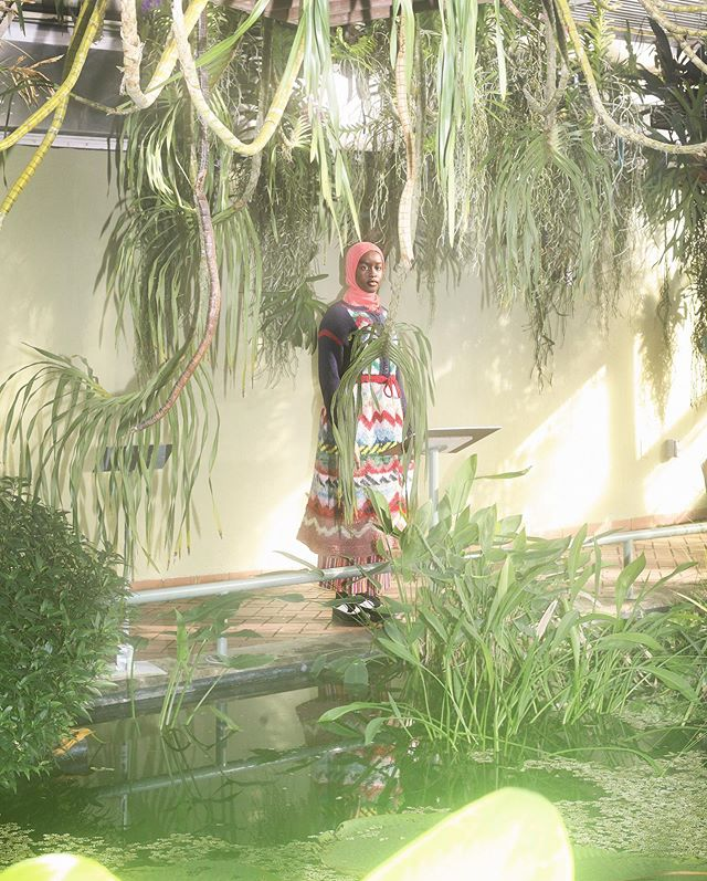 Sisi in the tropical climate room, viewing the giant Nymphaeaceae water lily pads.
