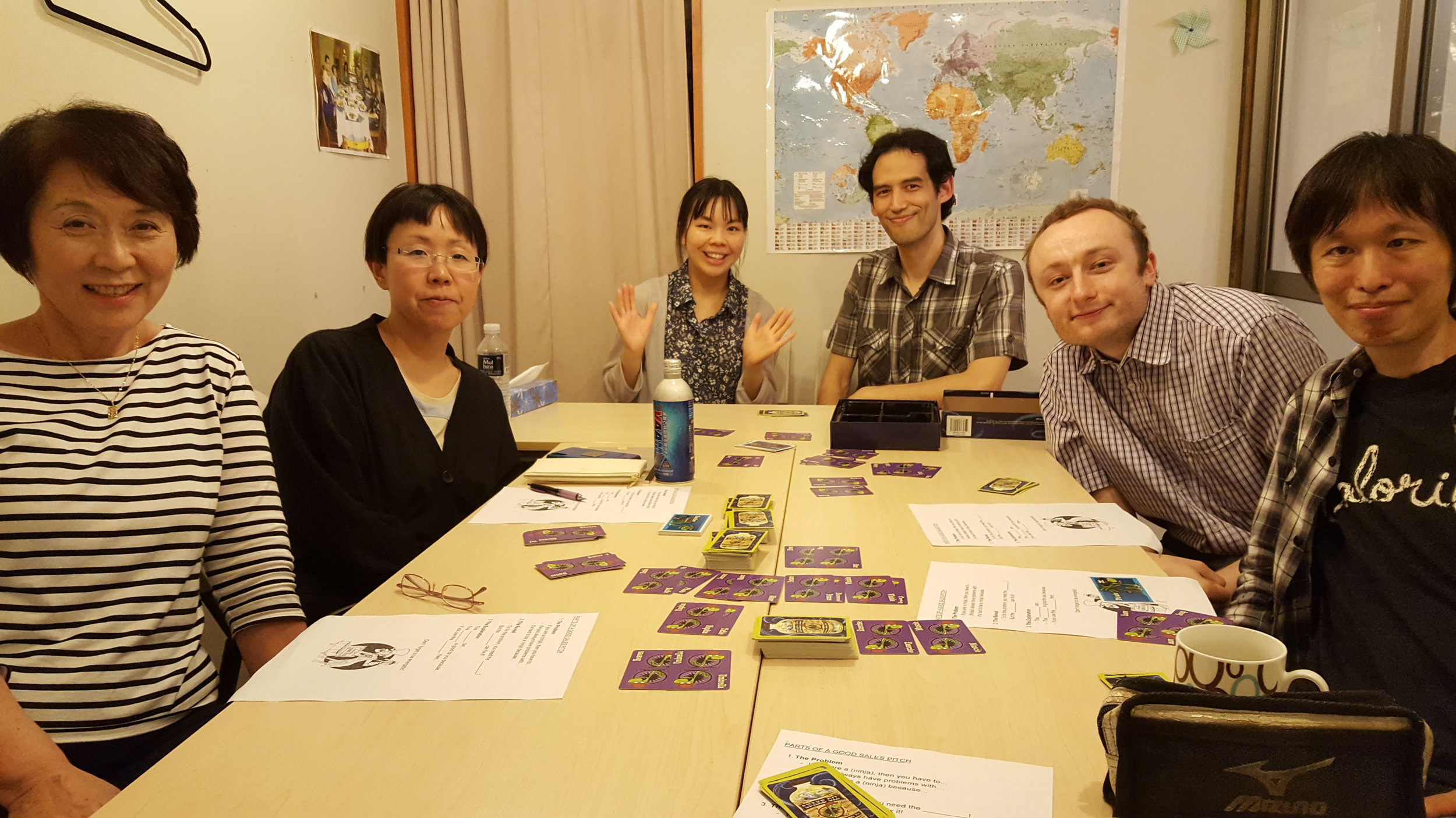 "Special guest teachers who are currently teaching English in Korea have come to introduce this amazing boardgame for our students. Now they are all professional ""snake oil"" salesmen."