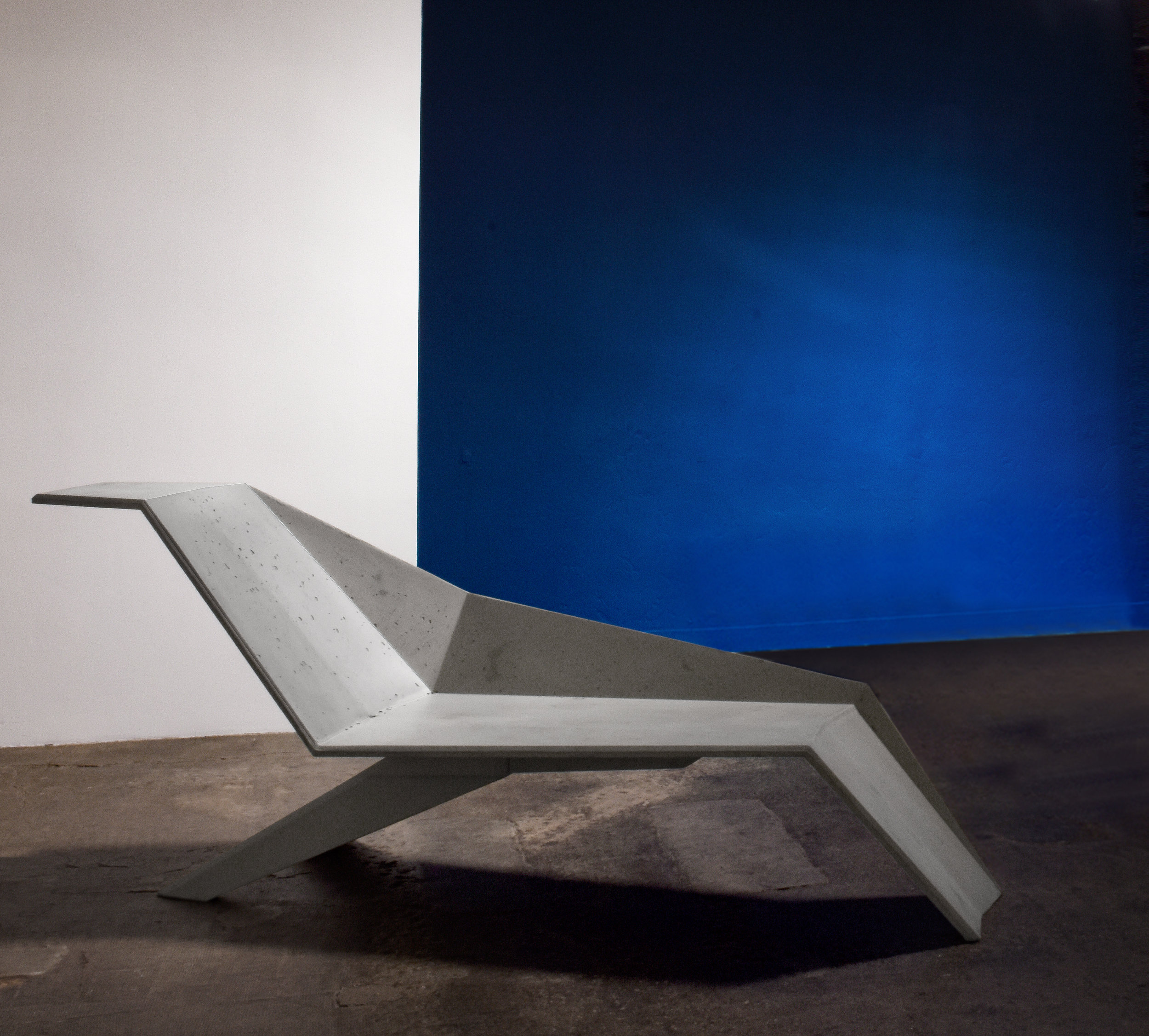 JIMMY DELATOUR - Resolutely brutalist, the cast concrete chaise longue unfolds in space, as an invitation to relax both indoors and outdoors.contact: info@delatourdesign.com