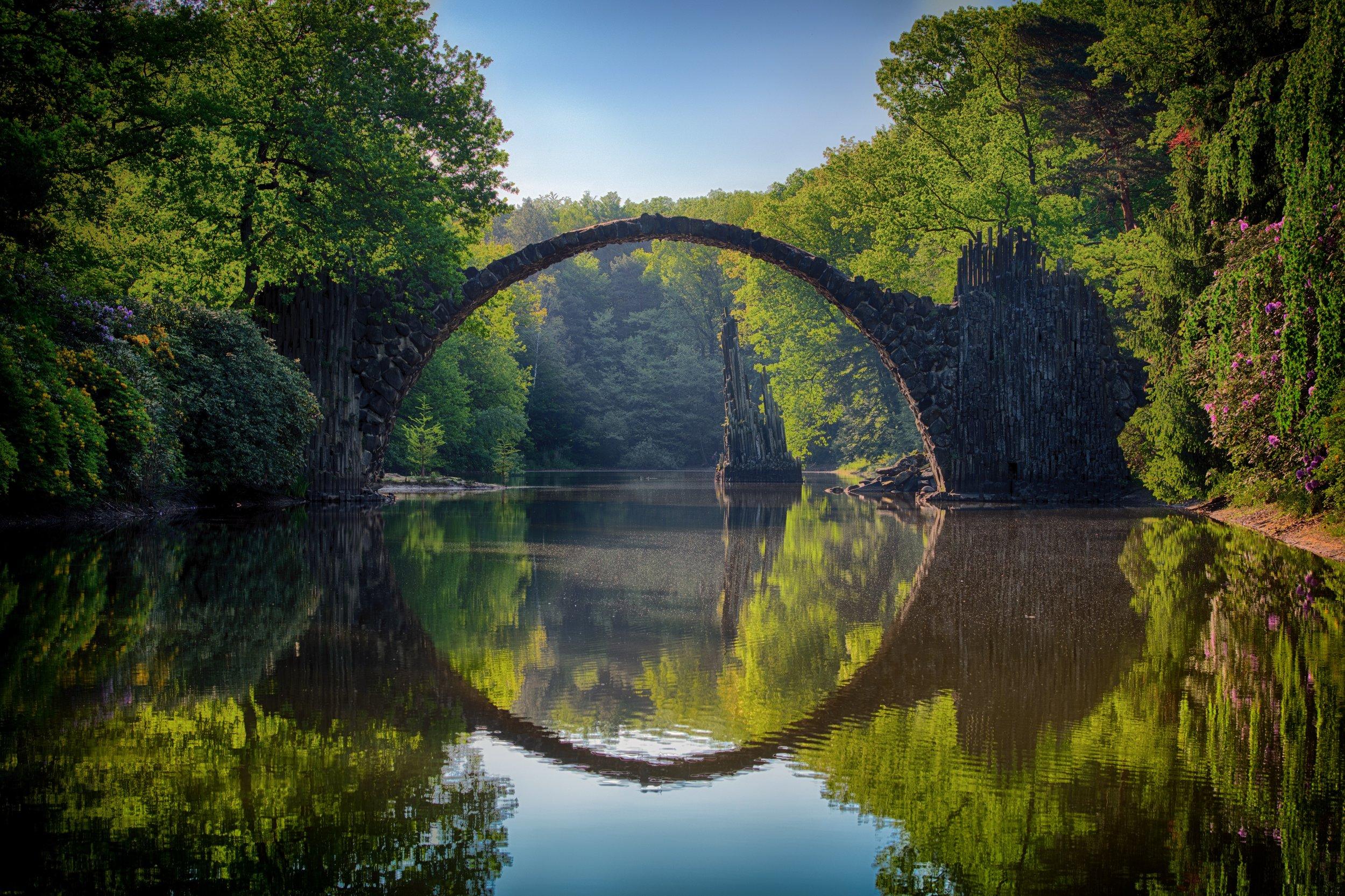 arch-bridge-clouds-814499.jpg