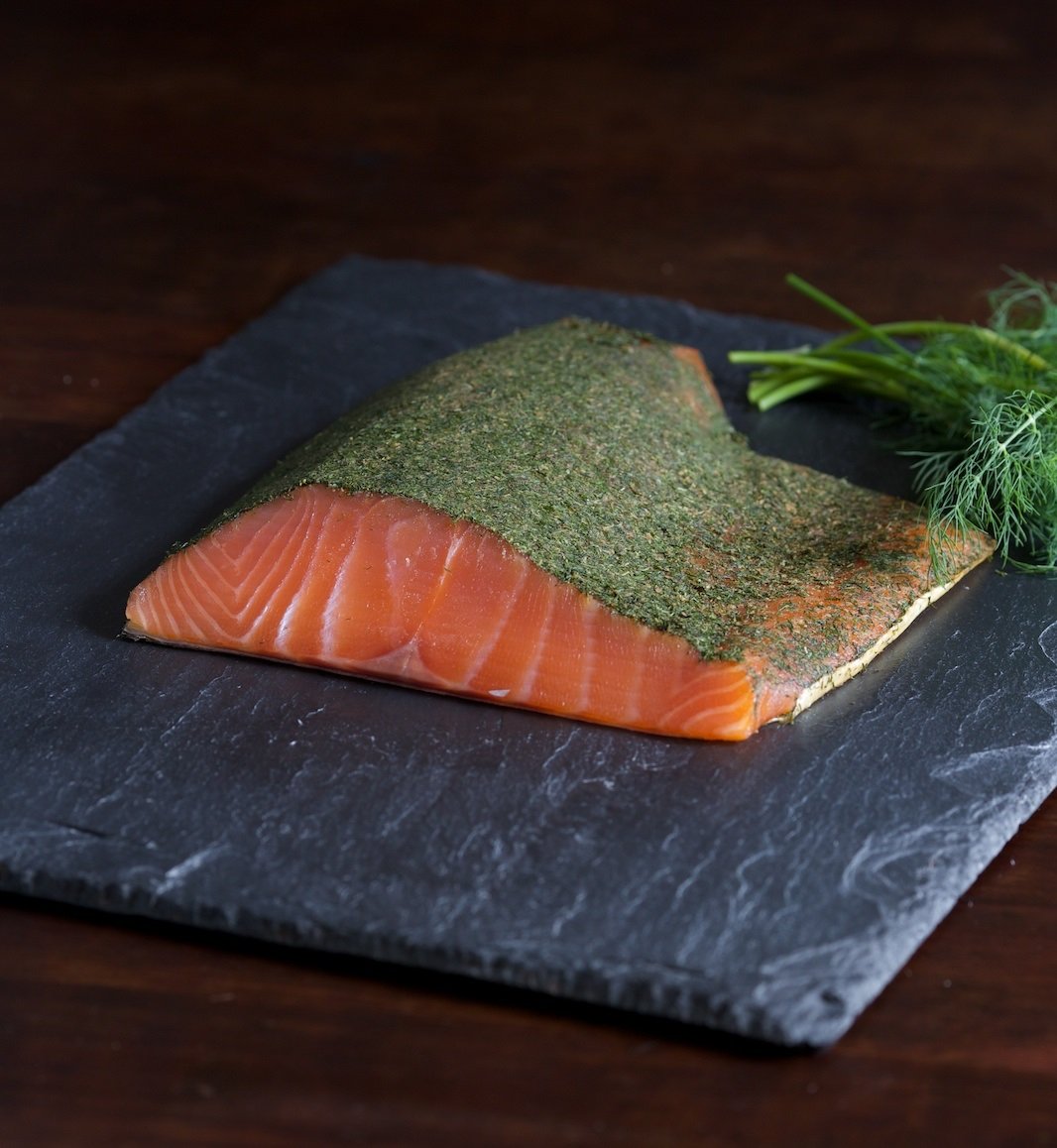 Gravlax - Gravlax is a Scandinavian cured salmon. We make ours with aged scotch whiskey, sugar, salt, dill and spices. It's a sweet, succulent salmon that is a welcome addition to an appetizer plate.