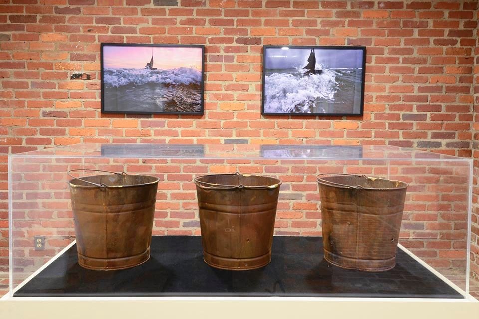 Cast Iron Cruise Line  photos 1 & 2 30 x 22 inches (Top)  B lack Leakage: Cast Buckets , 2016, Galvanized steel buckets and gold leaf Unique, 30 x 9 1/2 inches (Bottom)