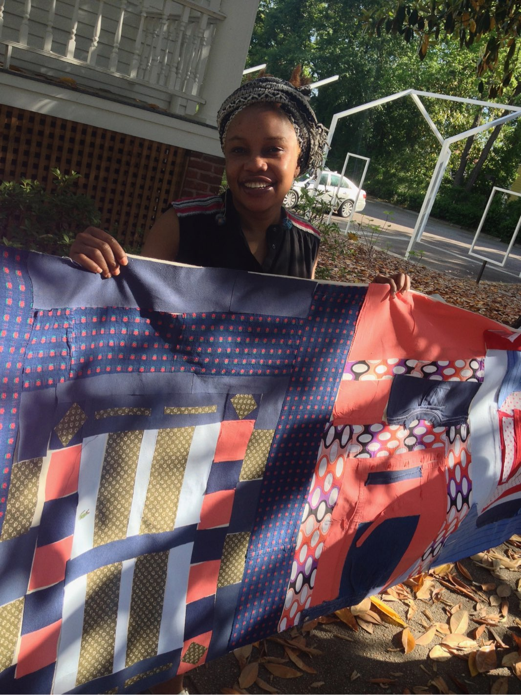 RTRS artist Victoria Idongesit-Udondian with community quilt  Code (I)