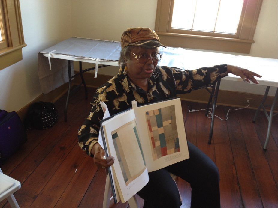 The late Marlene O'Bryant-Seabrook showing her quilt designs to the residents of the Marion Street High Rise