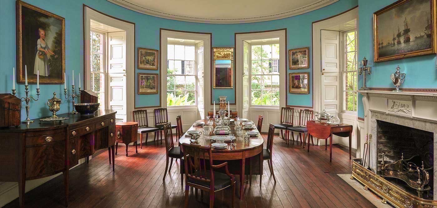 Interior view of first-floor, verditer blue dining room with Portrait of Alicia Russell, daughter of Nathaniel Russell, by Edward Savage (Left)