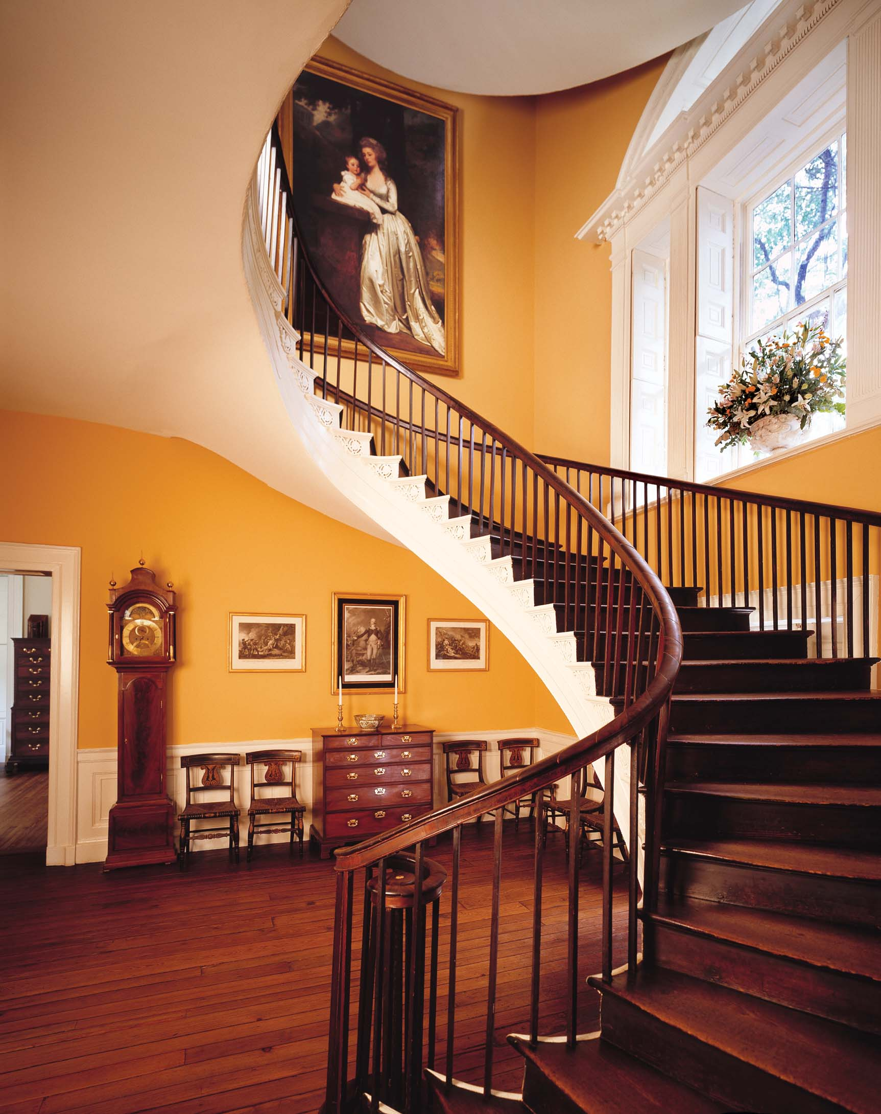 View of the only three story cantilever elliptical staircase in the United States with portrait of Mary Rutledge Smith by George Romney
