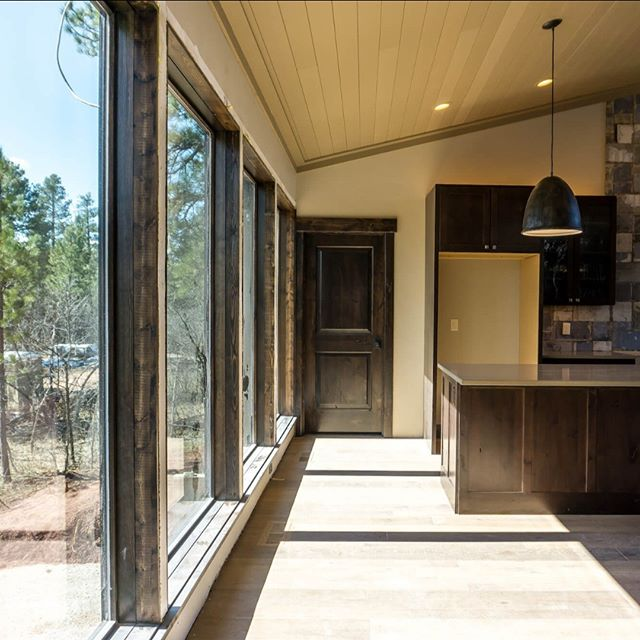 With views of nothing but the pine forest, oversized windows are a must. Builder: @jess.raemariehomes . . . #BFSBuilt #BFSSPearfish #buildersfirstsource #window #home #newconstruction #homeinspo #homeideas #wood #cabinlife #mountainliving #newconstruction #cabinets #newwindows #buildingmaterials #blackhills #pinetrees #spearfish #southdakota #blackhillshomes #raemariehomes #thetimbers #timbers #newbuild #contractorlife #doors #wooddoors #homeinspo #homegoals