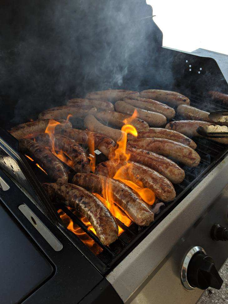 A grill full of brats during one of our many summer BBQ customer appreciation events.