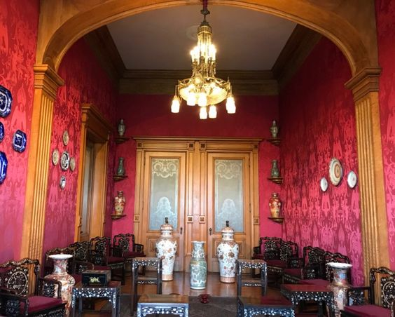 Interior room of a photo we took at Chapultepec Castle (Carmine Lake dyed fabric on the walls)