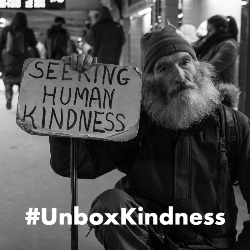 UnboxKindness - Cardboard Sign Background.png