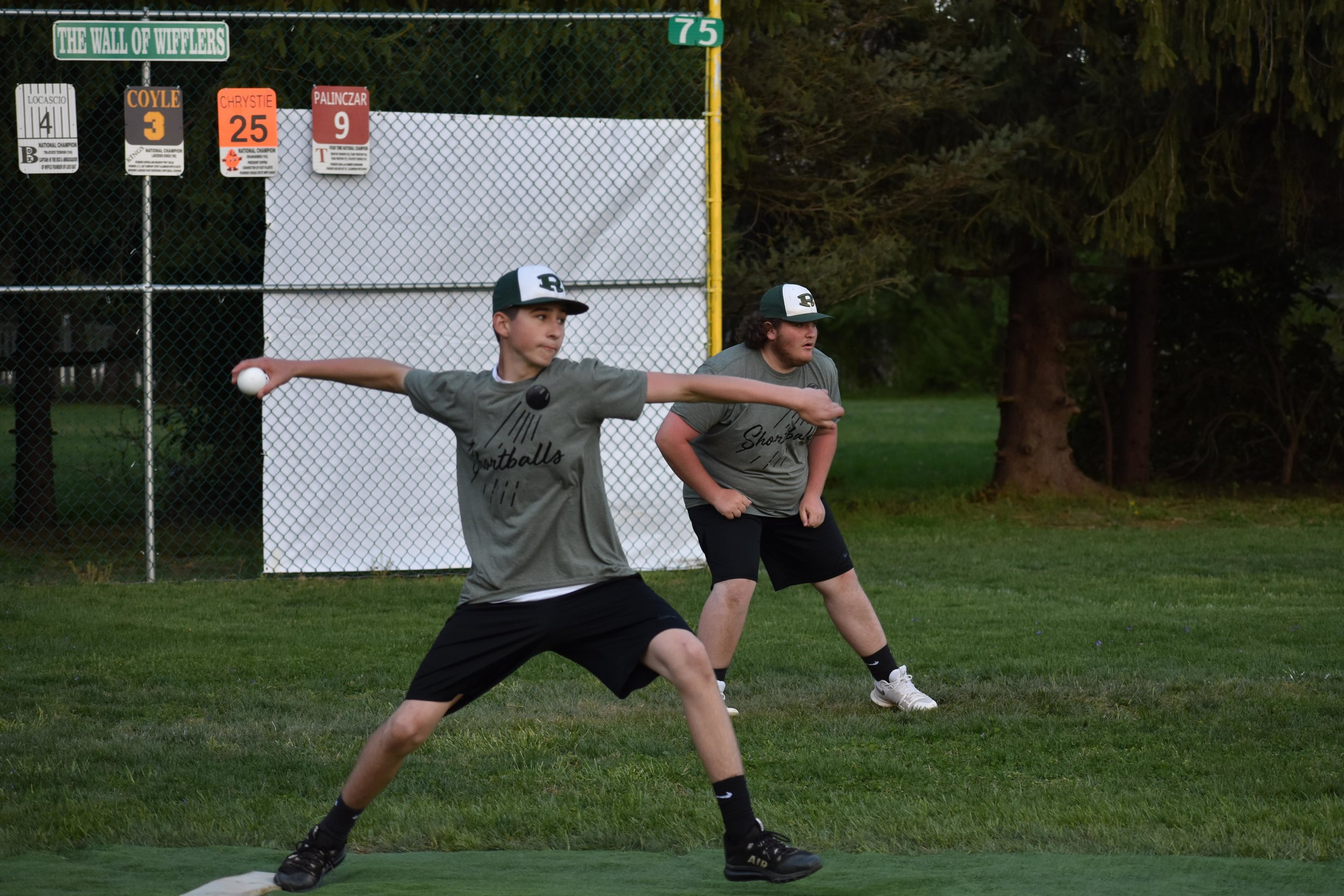 Teddy Drecher throws a pitch in the championship game as second baseman Vinny Albanese gets ready to field a potential ball in play (April 20, 2019)