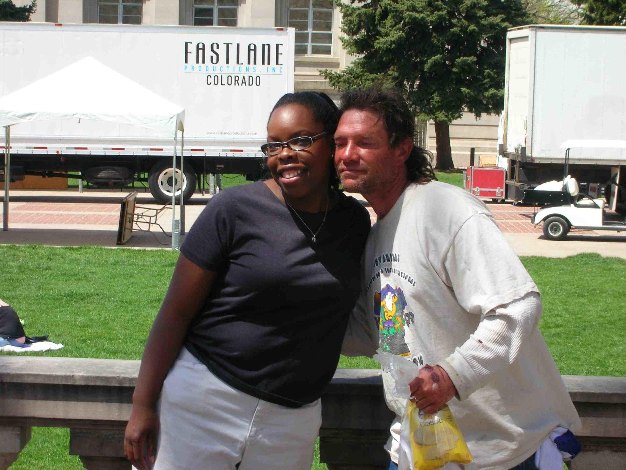 A grateful homeless man gives Sarah a hug.jpg
