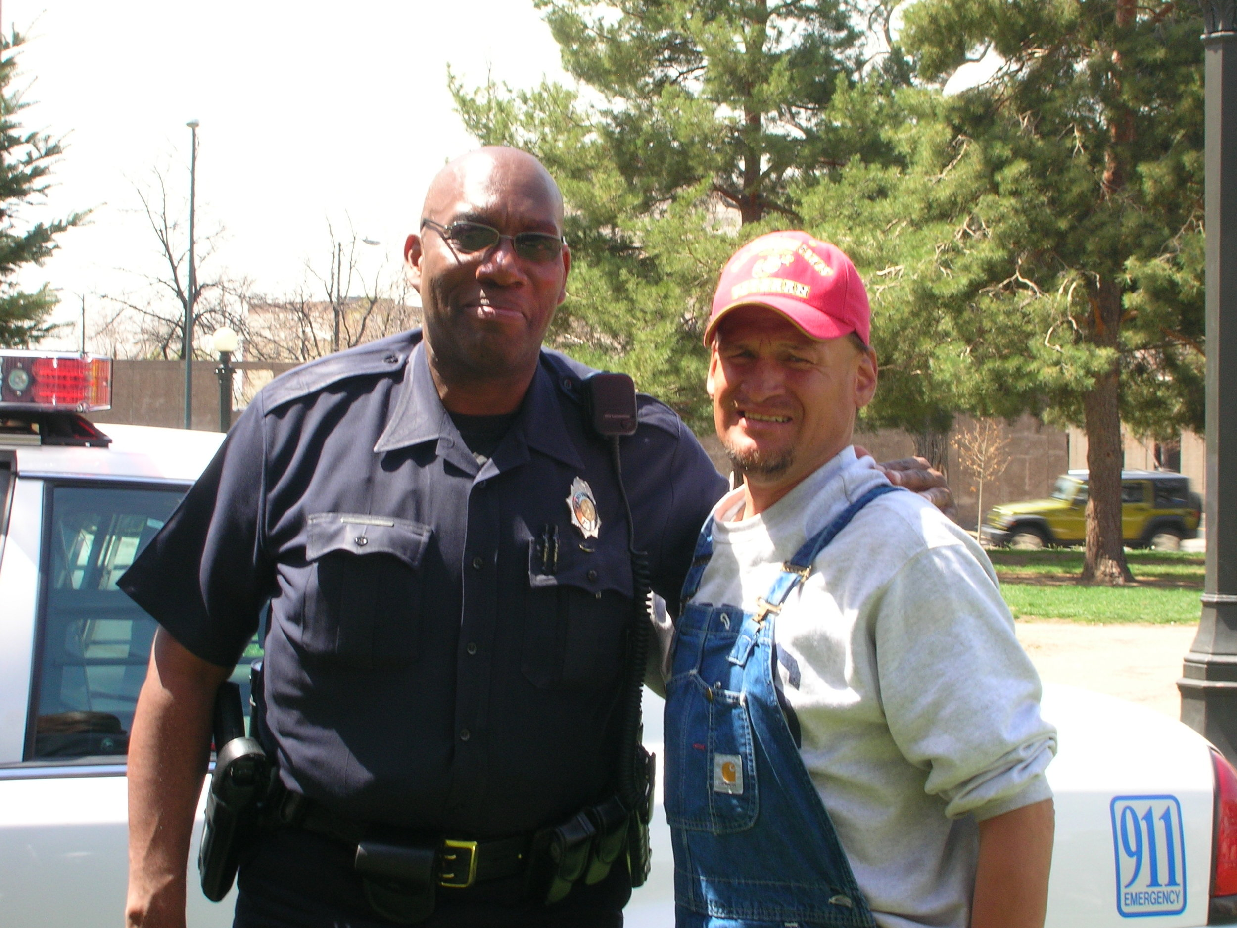 A Denver Police officer Thanks R2K for our kindness towards this man.JPG