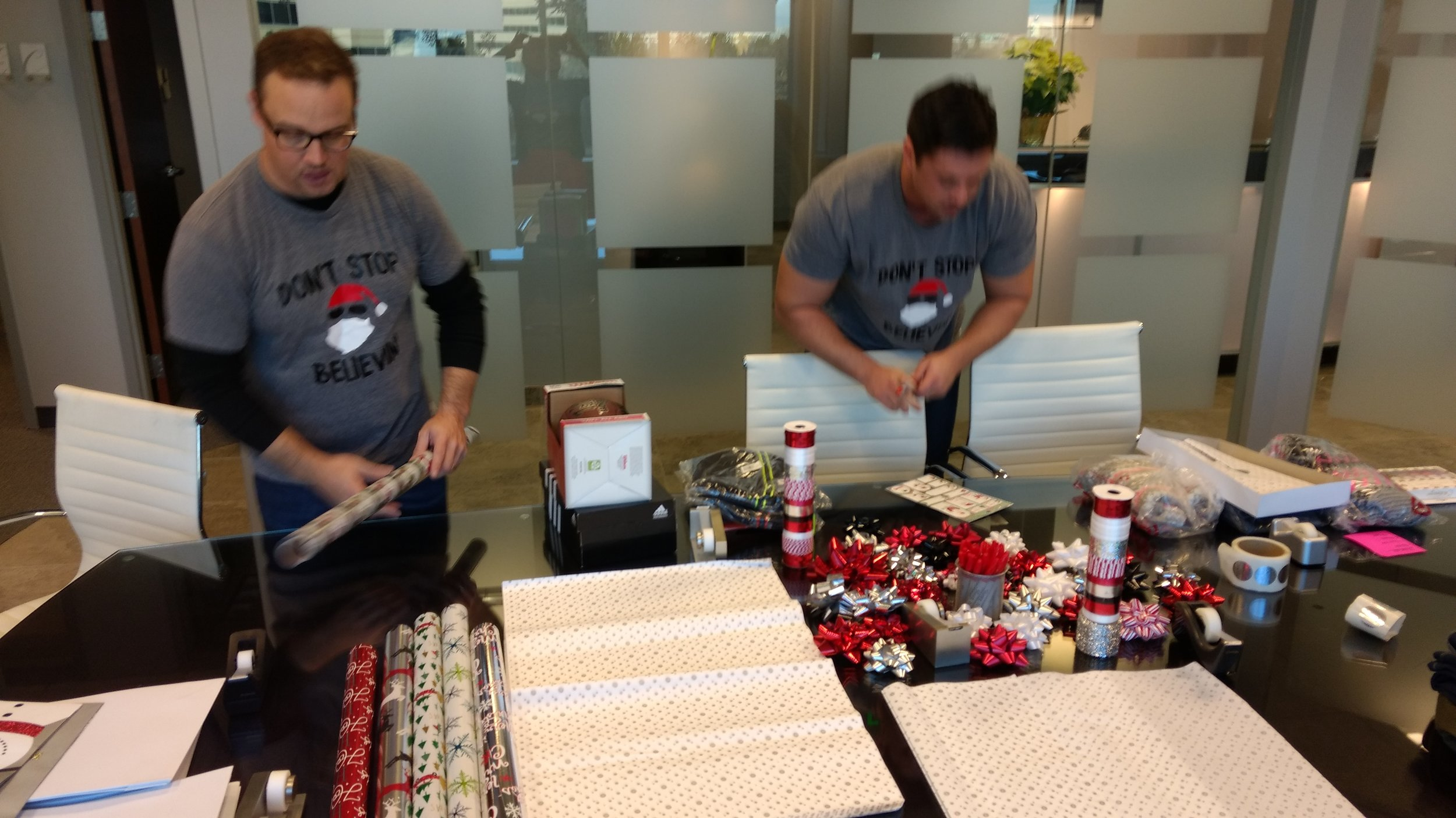 4-Matt and Eric are in deep focus and deep in wrapping paper.jpg