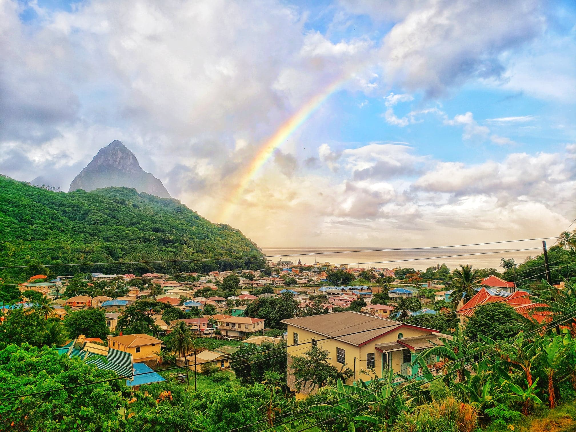 View of the Pitons in Soufriere, St Lucia with a rainbow photographed by Vision Balm in Charleston, SC.