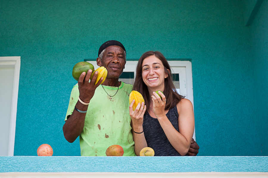 Portrait of man and woman with mangoes in St. Lucia by Vision Balm in Charleston, SC.