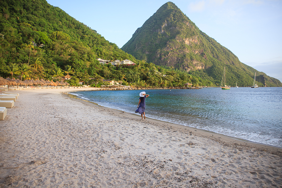 Photo of woman in red bikini at Sugar Beach in St. Lucia by Vision Balm in Charleston, SC.
