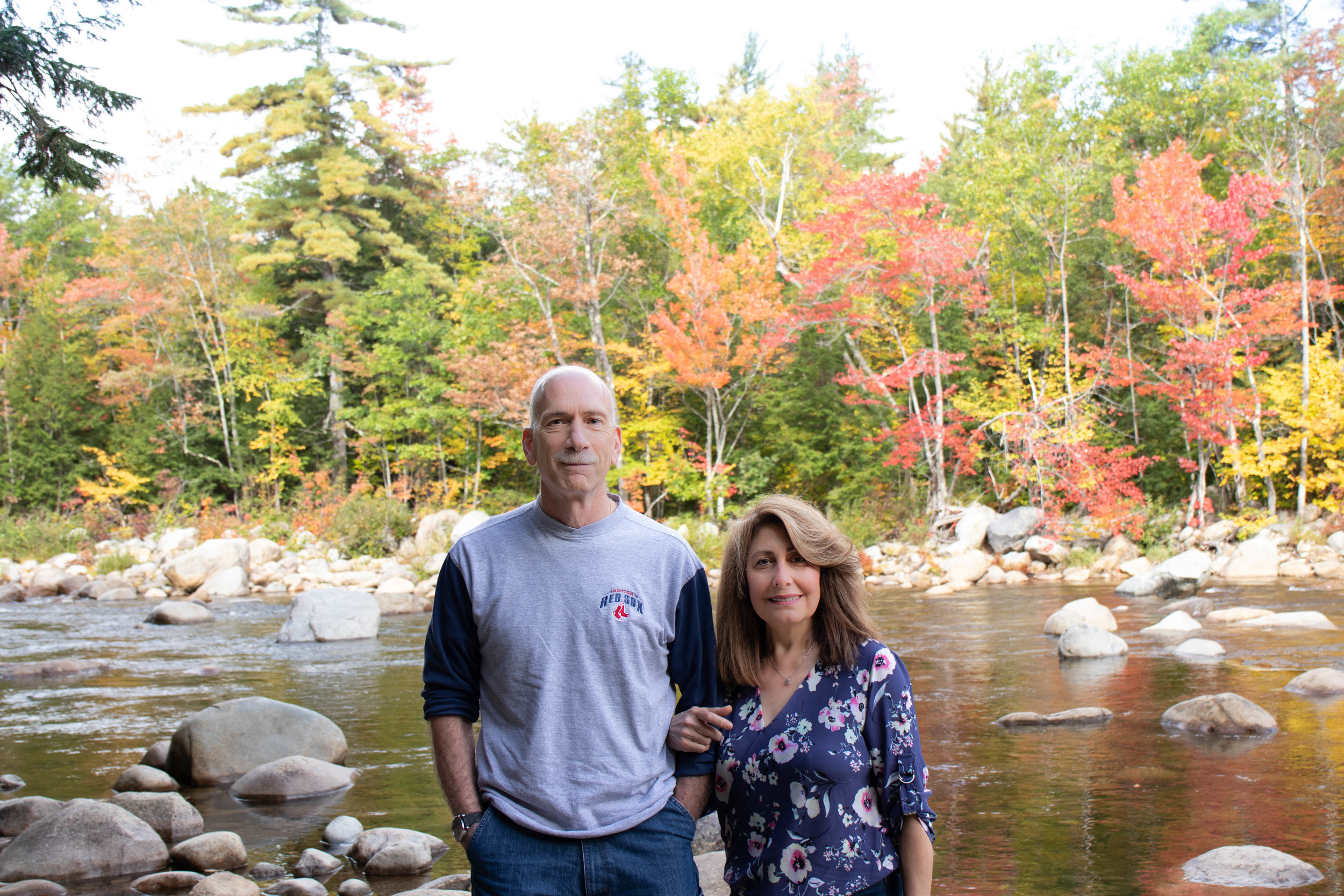 Family portrait of couple on the Kancamagus Highway in North Conway, New Hampshire during fall by Vision Balm in Charleston, SC.
