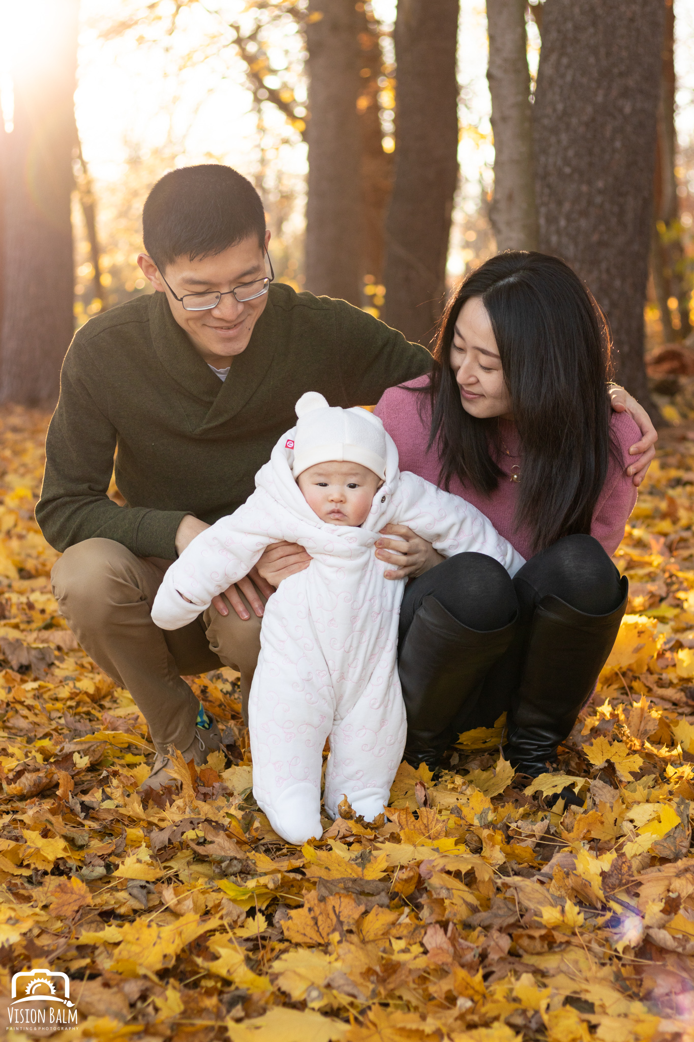 Family fall portrait of young couple with their baby in the park photographed by Vision Balm in Charleston, SC.