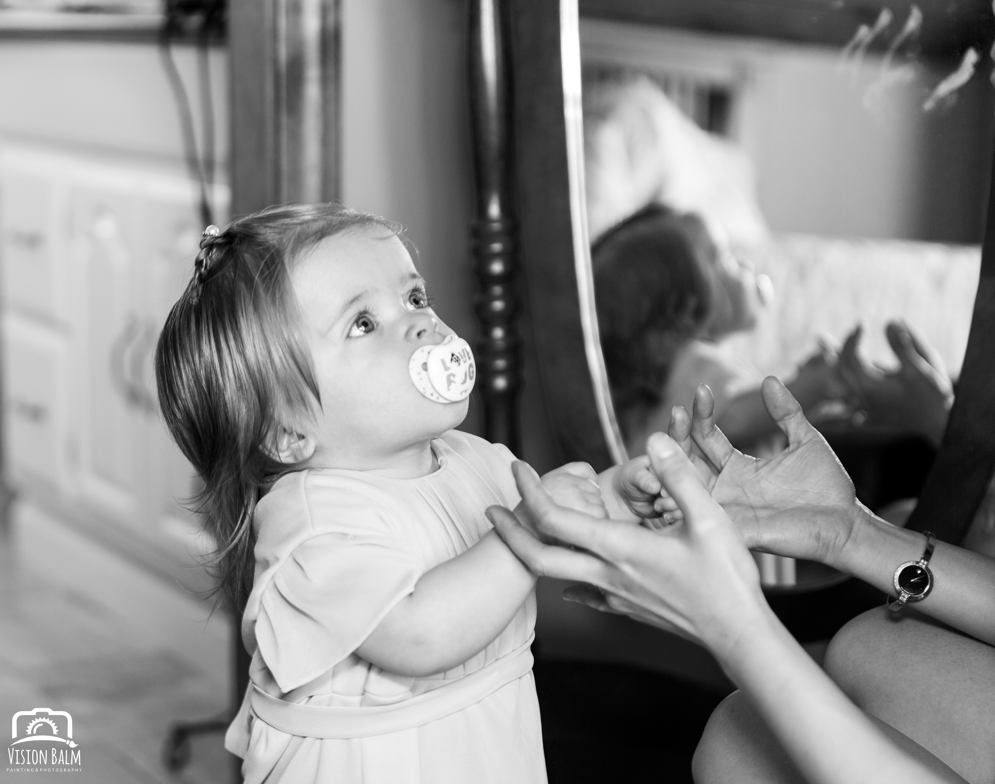 Lifestyle portrait of baby girl before the wedding in Zuka's Hilltop Barn by Vision Balm in Charleston, SC.