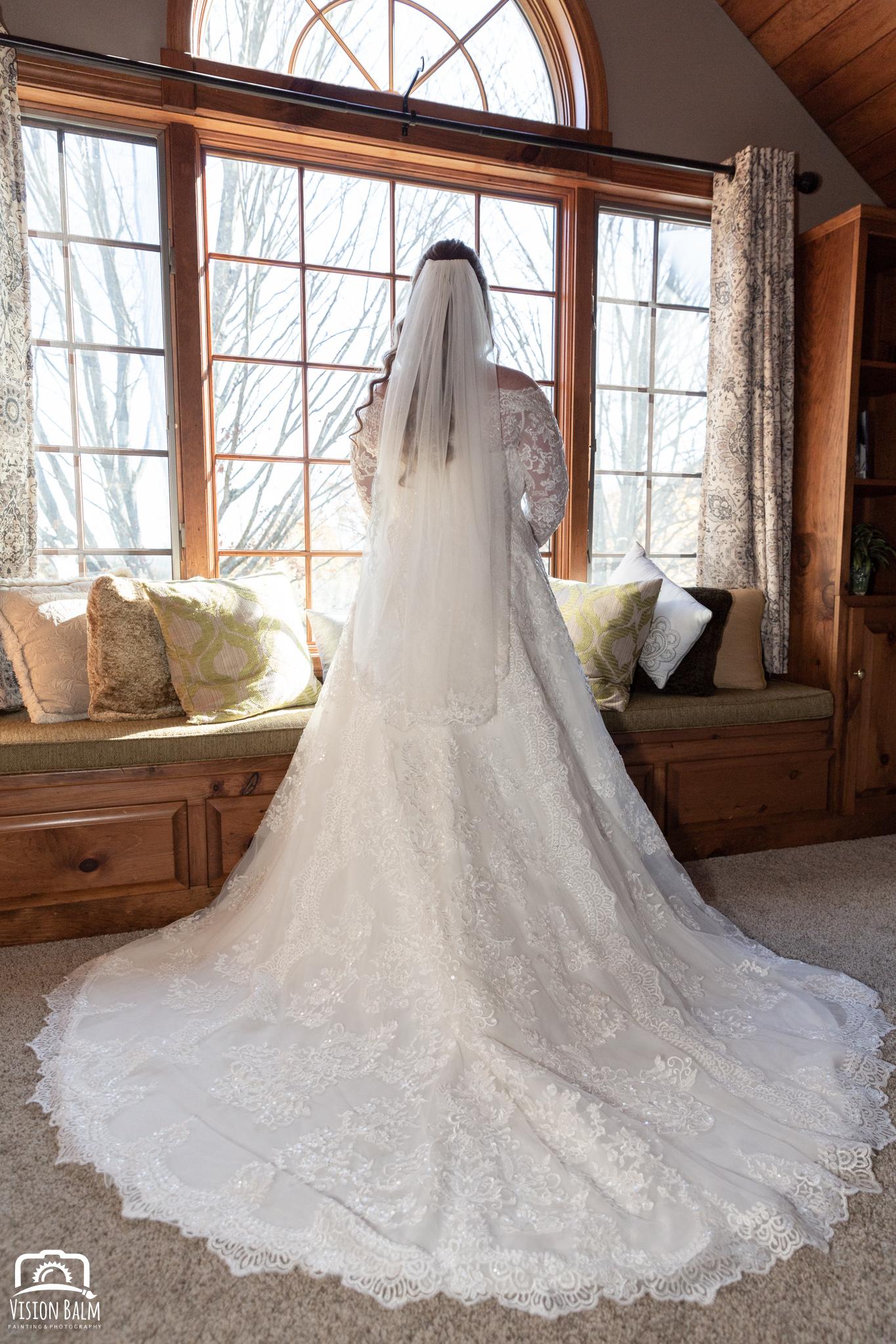 Lifestyle wedding photo of bride in her dress in Zuka's Hilltop Barn by Vision Balm in Charleston, SC.