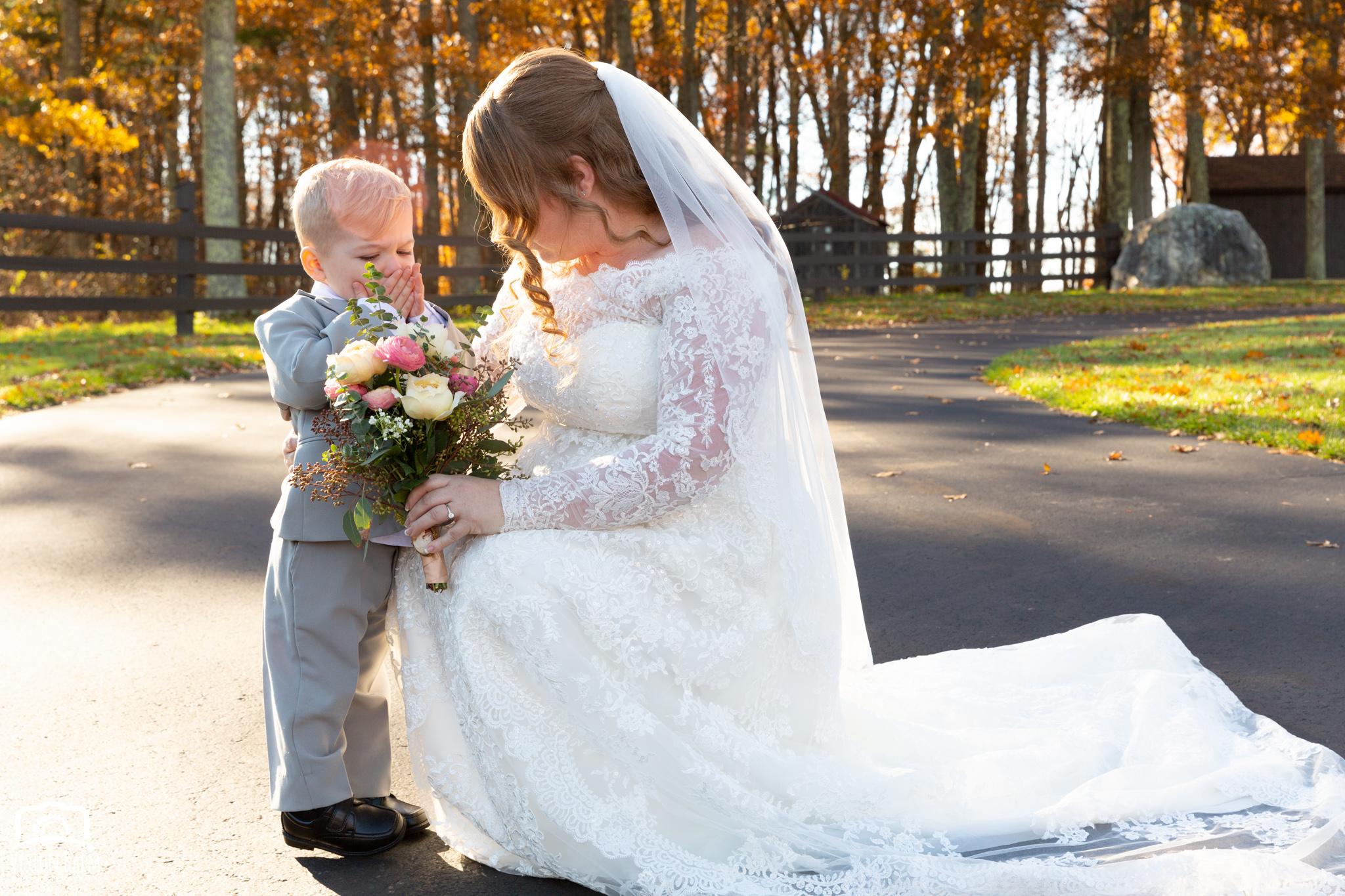 Wedding formal photo of bride and her children in Zuka's Hilltop Barn by Vision Balm in Charleston, SC.