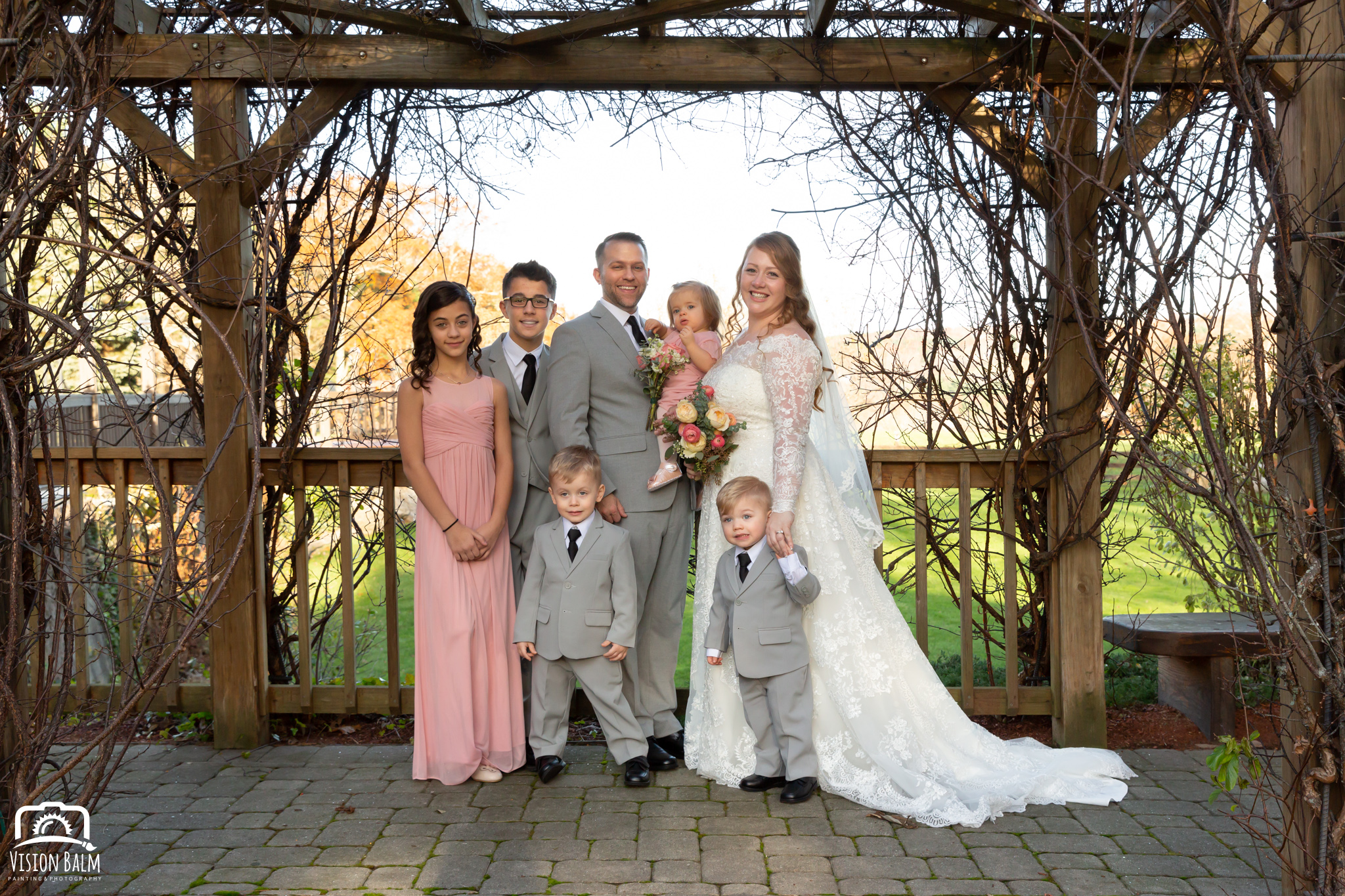 Wedding formal photo of bride and groom's family in Zuka's Hilltop Barn by Vision Balm in Charleston, SC.